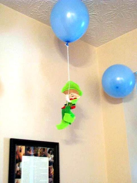 elf on the shelf hanging from balloon