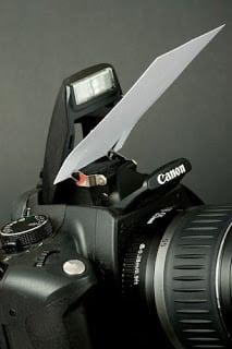 white card against camera flash