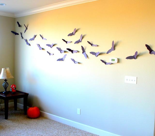 paper bats on a wall