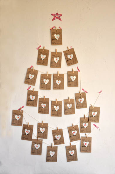 brown paper cards on wall arranged to look like a tree