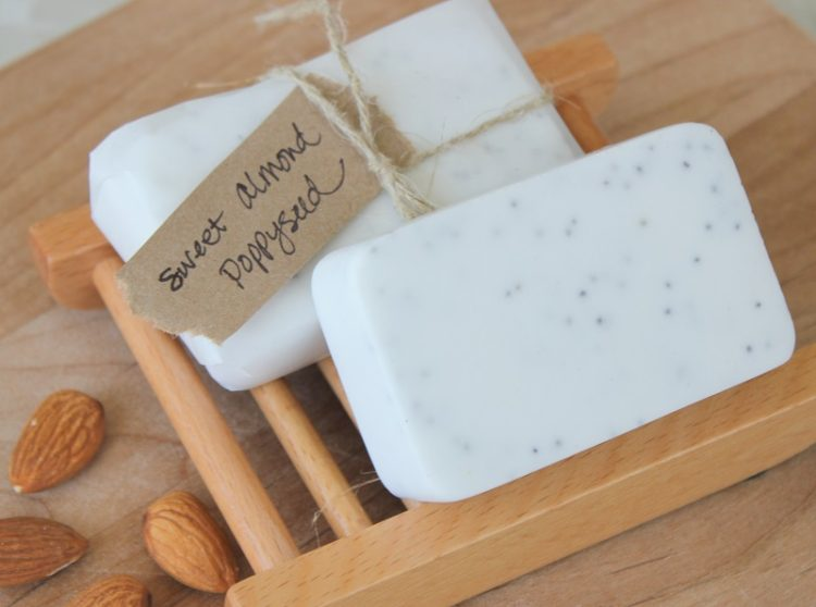 two bars of poppy seed soap on soap holder