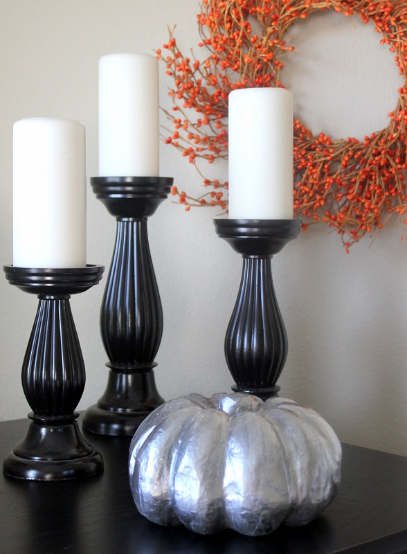 black candlesticks and silver pumpkin