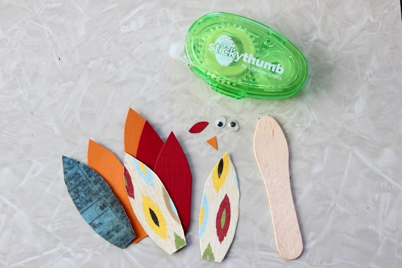paper feathers and wooden craft stick