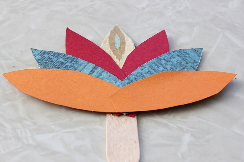 paper feathers glued to stick