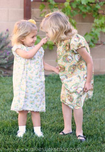 little girls wearing cotton peasant dresses