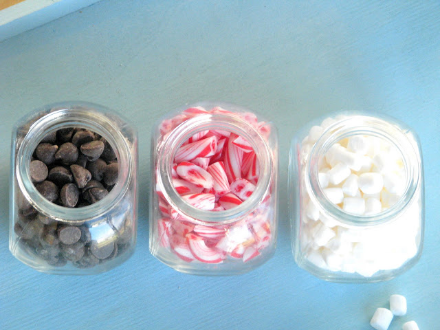 candy jars filled with chocolate chips and marshmallows and peppermint candy