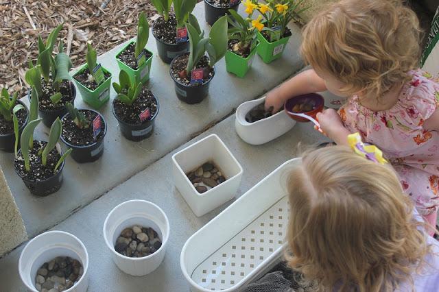 children planting bulbs in planter