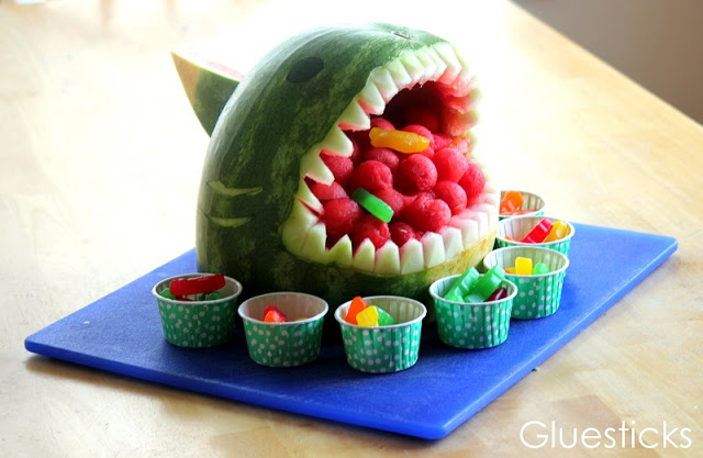 watermelon shark and cups of gummy candies