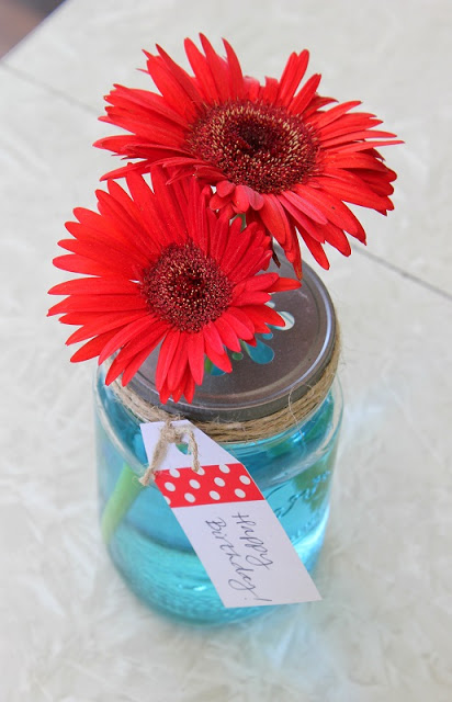 jar with blue water and flowers