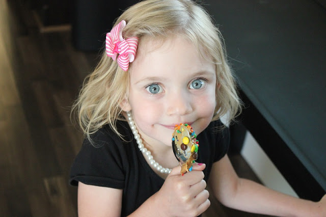 toddler with peanut butter spoon