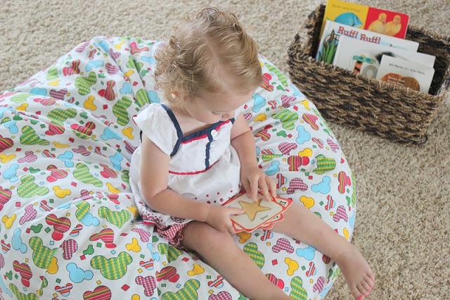 toddler sitting on bean bag