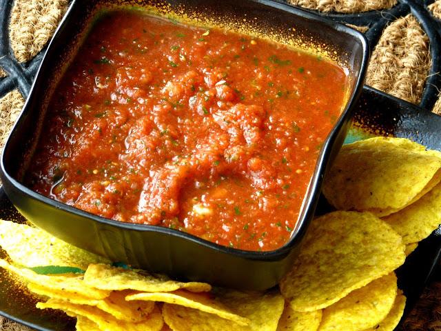 blender salsa in bowl with chips