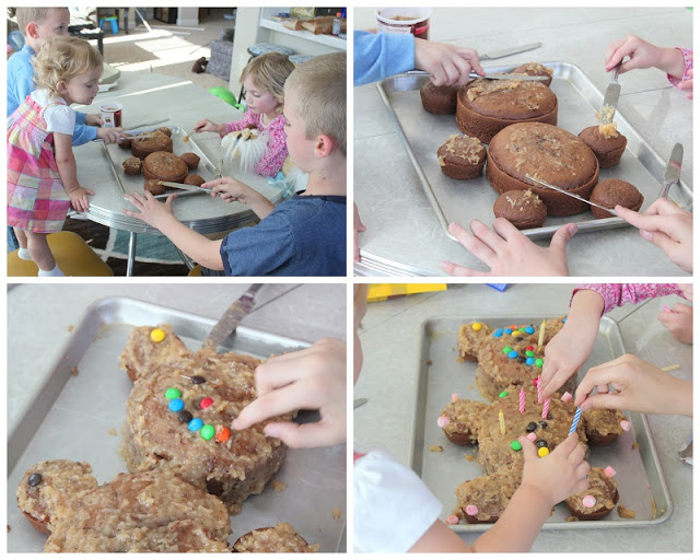 children decorating teddy bear shaped cake