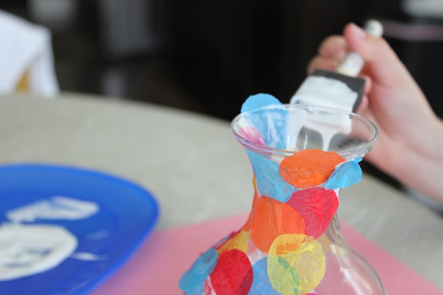 This tissue paper vase is such a fun project for kids! Just brush mod podge over the glass, add the tissue paper circles, then add another coat of mod podge to make it water resistant!