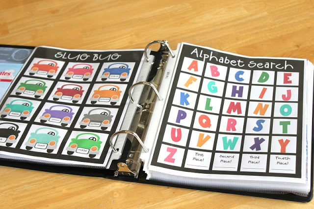 black binder open with printable games in page protectors