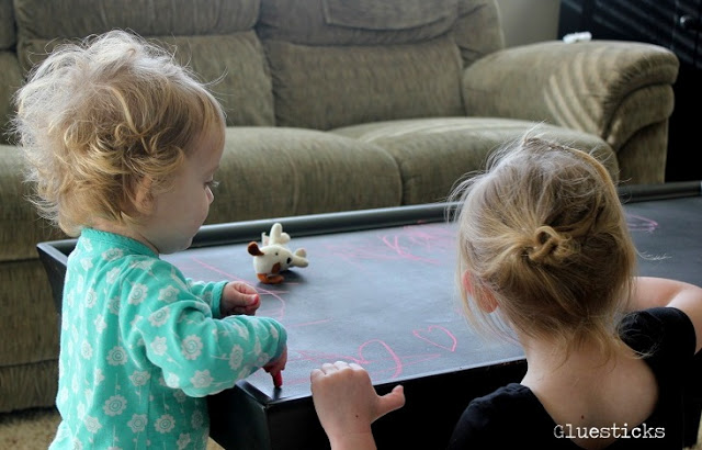 children drawing on chalkboard table