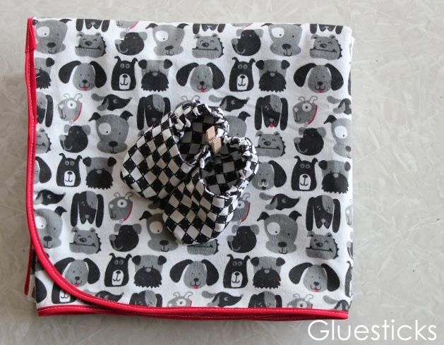 folded blanket with baby shoes