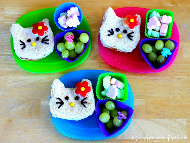 hello kitty shaped sandwiches on colored plates
