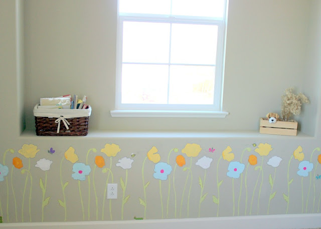 beige wall with window seat stenciled with poppies