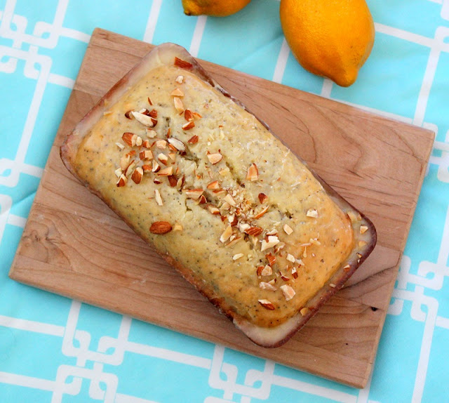 Almond poppy seed bread with a delicious lemon glaze and crunchy almonds on top. This recipe makes 2 loaves; one for you and one for a friend!