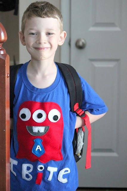 boy wearing blue monster shirt