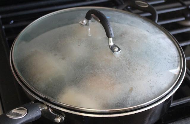 chicken Florentine cooking in pan