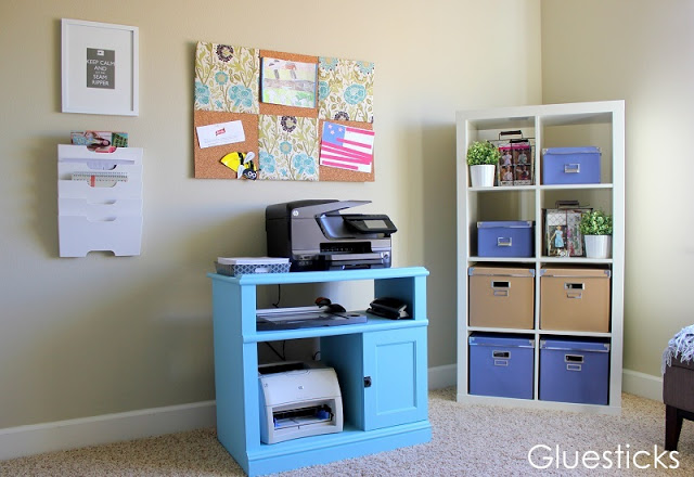 turquoise painted printer table in office