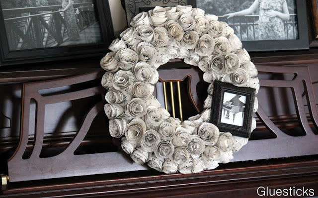 music wreath propped against piano