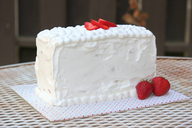 frosted pound cake with strawberries