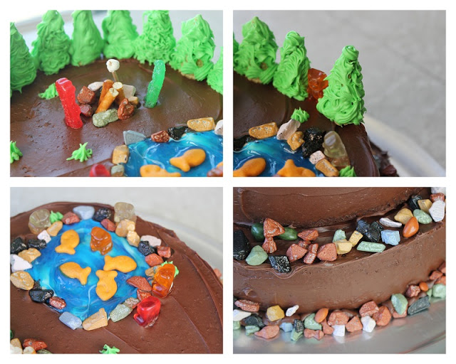 camping themed cake with gummy bears and candy rocks