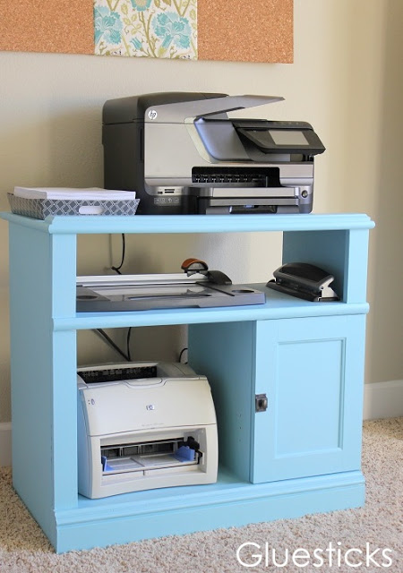 old entertainment stand painted blue