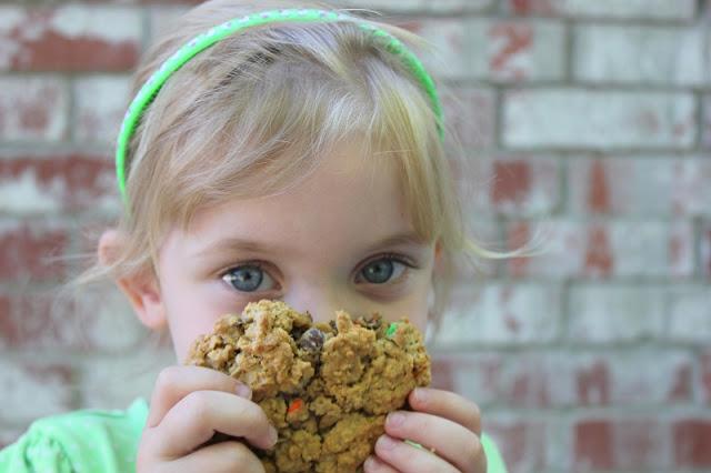 little girl eating monster cookie