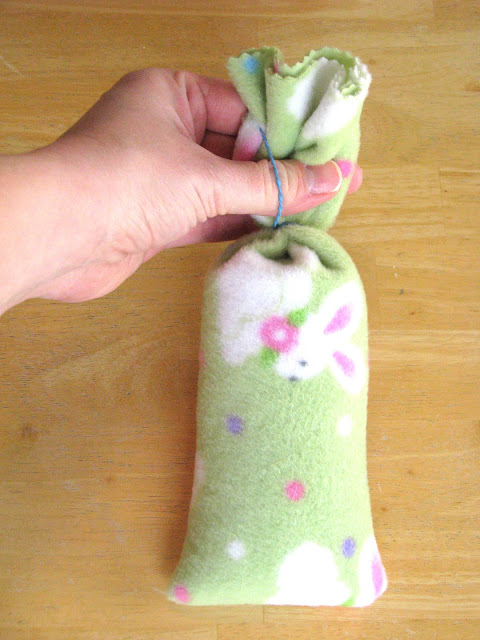 top of bunny tied off with rubber band