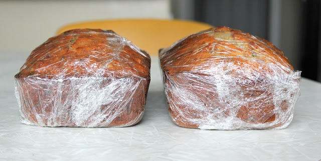warm banana bread wrapped in plastic wrap