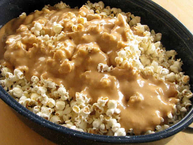 caramel poured over popped popcorn