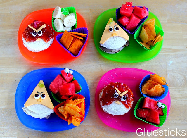 angry bird sandwiches on colored plates