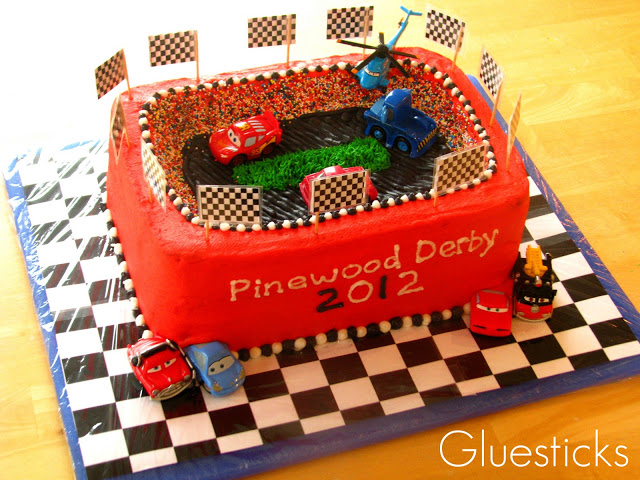 race track themed cake on cake board