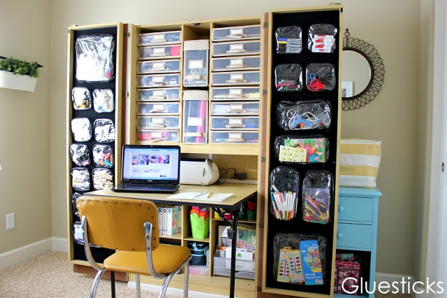 craft hutch open with velcro attached clear pouches with craft supplies