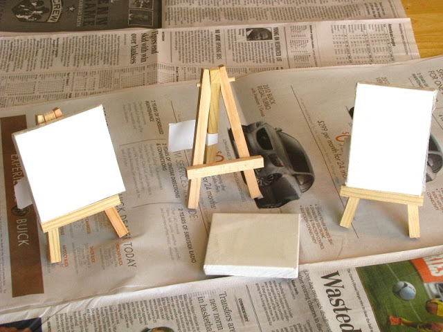 mini canvases on newspaper with small easels