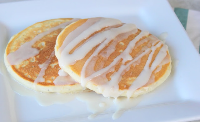 Light, fluffy, and drizzled in vanilla glaze. These almond poppy seed pancakes are absolutely perfect and easy to make. Make a batch this weekend!