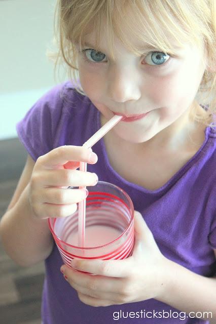 child drinking yogurt smoothie with straw