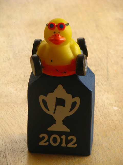 wood pinewood derby trophy with rubber duck