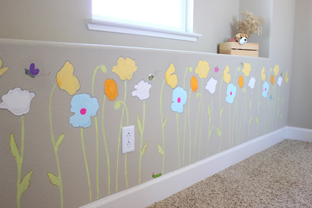 poppies stenciled on beige wall