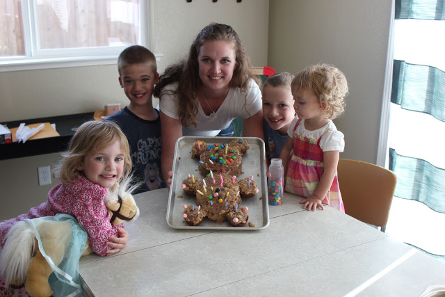 children and mom with teddy bear cake