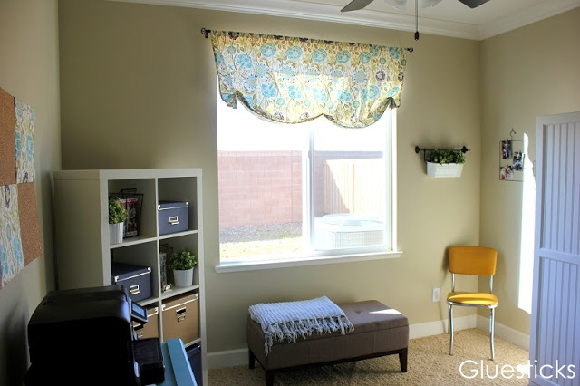 window ottoman with window treatment in home office