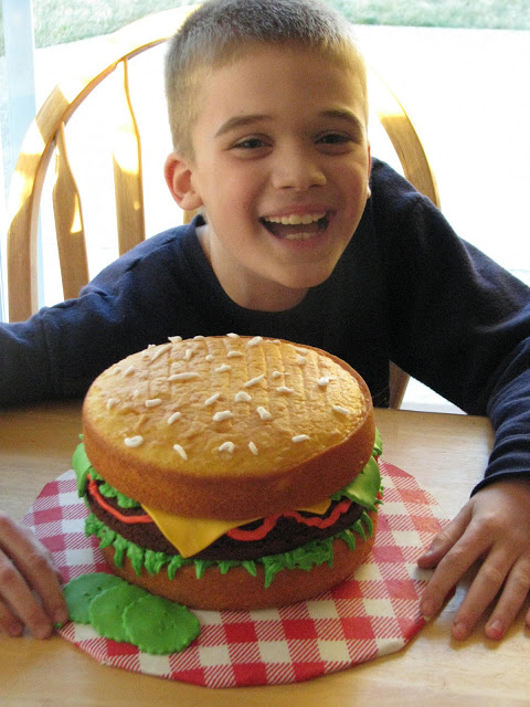 child with finished hamburger cake