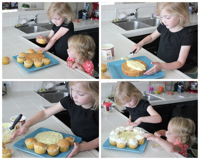 child frosting cupcakes for flower cake