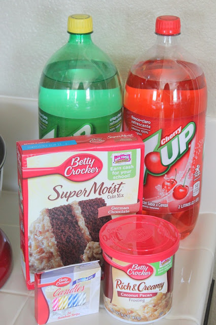 cake mix, frosting and two bottles of soda
