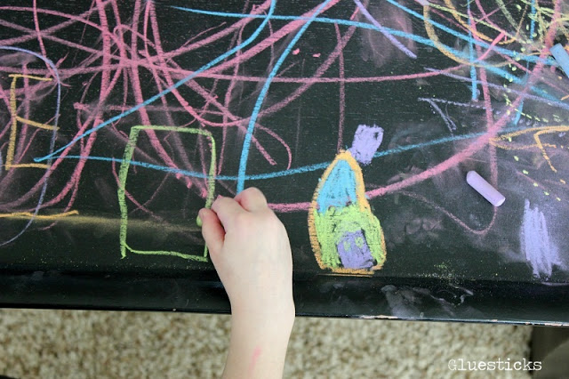 hand drawing with chalk on table