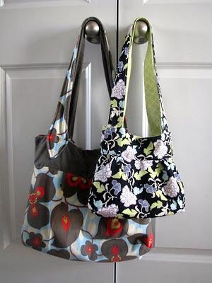 large and small handbags on door knob